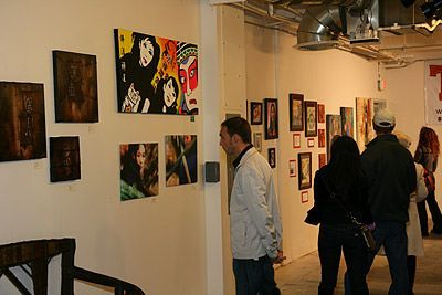 Many attendees took time to really study the various Asian art on display.