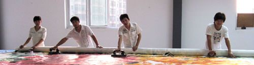 Lots of manpower to mount big Chinese painting