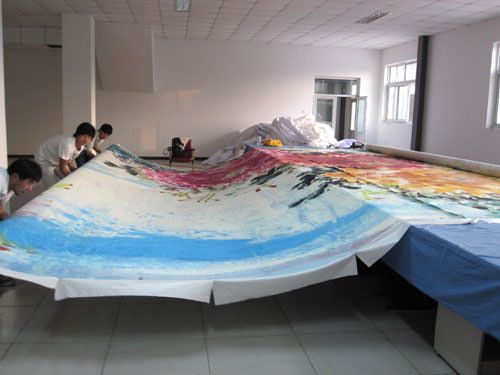 Rolling up the big Chinese painting