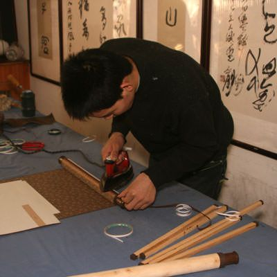 Finishing the wall scroll roller installation